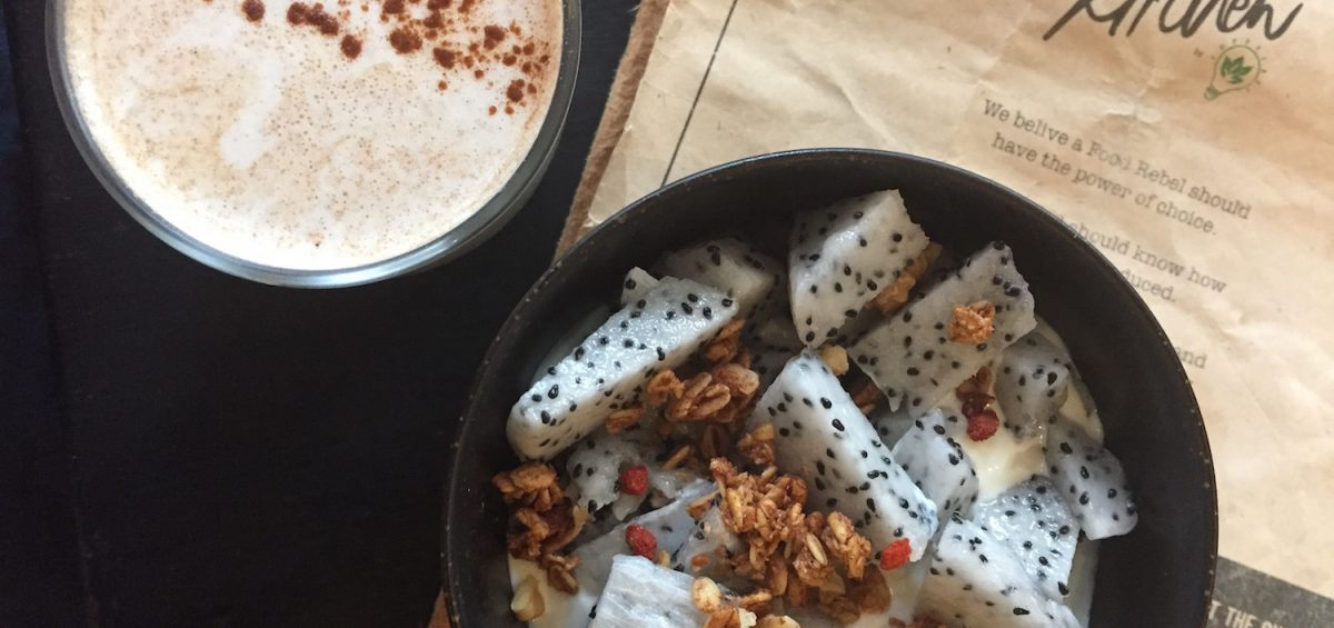 Healthy eats almond milk latte and dragon fruit bowl with granola